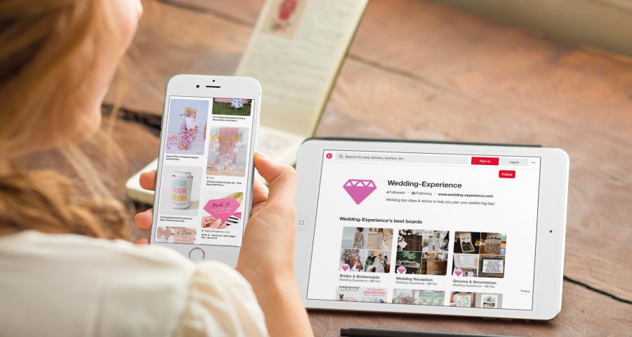 Woman using Pinterest app to plan wedding