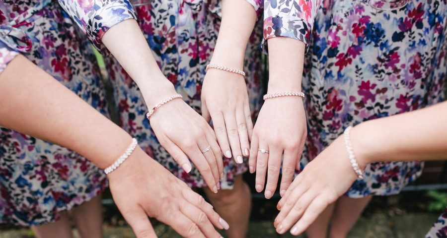 Bridesmaids wear Etsy bracelets and robes