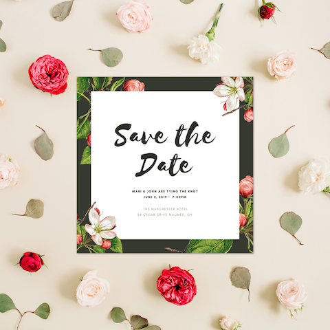 Example of a Canva Save the Date template surrounded by flowers
