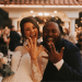 Couple shows off their wedding rings at wedding reception