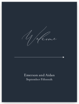 """Navy blue welcome wedding sign with white text. Arrow points to right with text """"Emerson and Aiden September Fifteenth"""" below."""