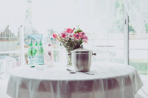 Garden Style Bridal Shower with Sparkling Water and Flowers on table
