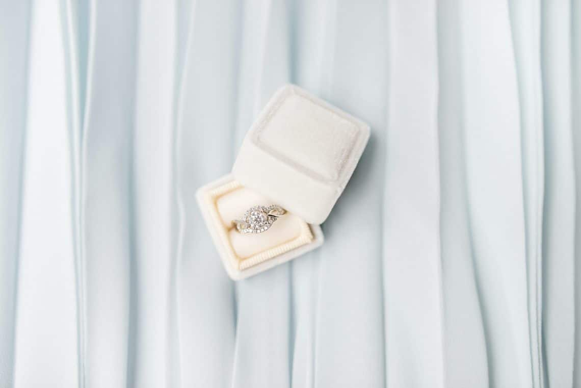 Engagement ring in white velvet box
